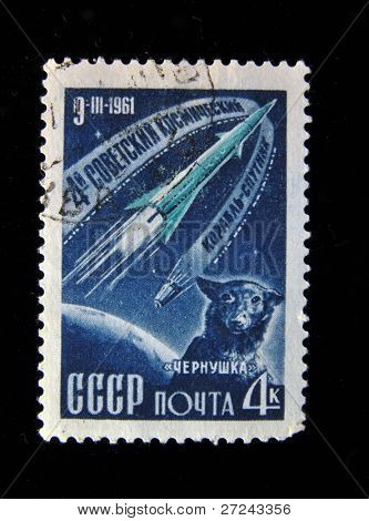 USSR - CIRCA 1961: A stamp printed in USSR shows fourth Soviet space ship with a dog on board