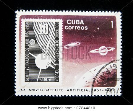 CUBA - CIRCA 1977: Series of stamps printed in Cuba shows philatelia items honoring First soviet sputnic, on this stamp shows stamp from German Democratic Republic, circa 1977.