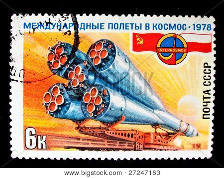 USSR - CIRCA 1978: A stamp printed in the USSR devoted to the Soviet-Polish cooperation in the Intercosmos program shows a spaceship being taken to the launch pad, circa 1978. Big space series