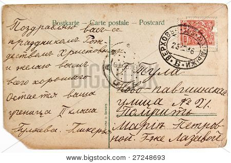 RUSSIA  - CIRCA 1916. Reverse side of an old postal card with a tsarist Russia postage stamp and a letter with congratulation to Christmas. Circa 1916.