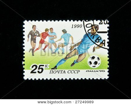 USSR - CIRCA 1990: A stamp printed in the USSR shows football player (IV FIFA World Cup, Italy, 1990), circa 1990. 5 postage stamp series