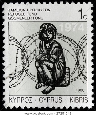 CYPRUS - CIRCA 1989: A stamp printed in Cyprus shows image of a child sitting next to barbed wire, series, circa 1989