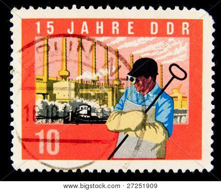 GDR - CIRCA 1964:A stamp printed in East Germany showing the image of metallurgist, series, circa 1964