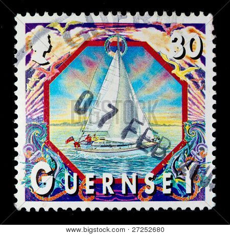CHANNEL ISLANDS - BAILIWICK OF GUERNSEY - CIRCA 1990s: a stamp showing an image of people sailing off Guernsey, circa 1990s