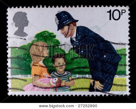 ENGLAND-CIRCA 1980s:A stamp printed in England shows image of the British police and children, circa 1980s.