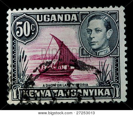 UGANDA PROTECTORATE - CIRCA 1946: A stamp printed in the Uganda Protectorate shows image of a boat, series, circa 1946