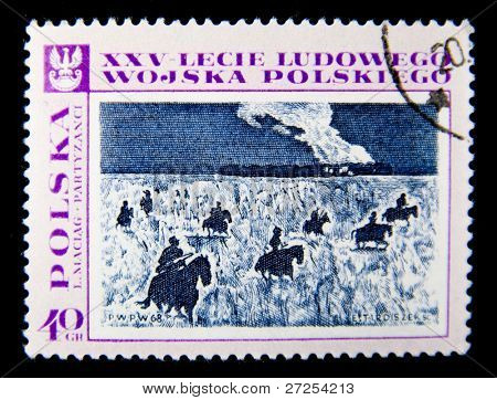 POLAND - CIRCA 1968: A stamp printed in Poland devoted 25 years of Polish army shows Group of the armed horsemen in the military form, circa 1968.