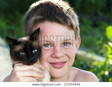Blue-eyed boy and a Siamese cat