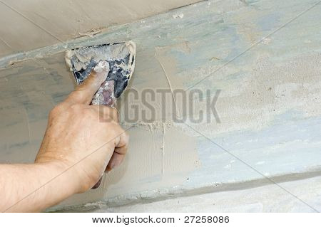 plasterer putty joints with surfacer