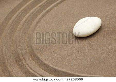 zen garden of sand and stone with copy-space