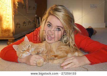 Girl Cuddling Her Pet Cat