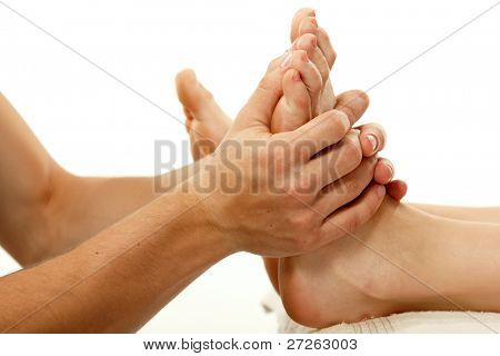 Massage Fuß weibliche hautnah isoliert auf weißem Hintergrund