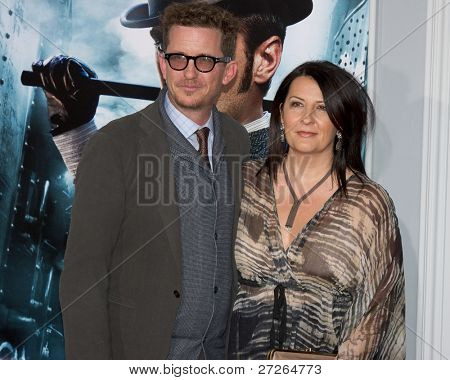 WESTWOOD, CA - DECEMBER 6: Screenwriters Kieran and Michele Mulroney arrive at the premiere of