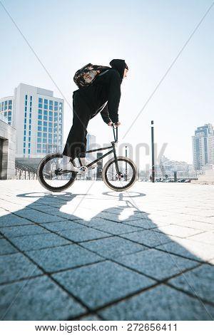 Young Man Riding A Bmx