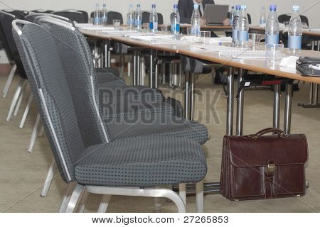 Portfolio under a table in the conference hall
