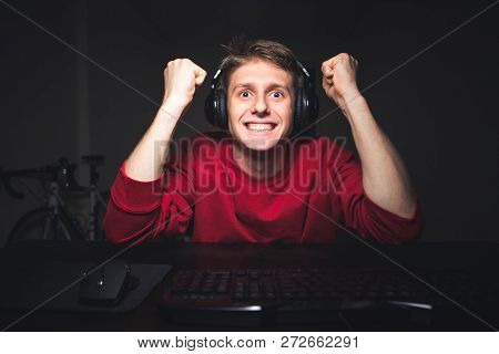 poster of Emotional Gamer Sits Home In The Room At Night And Plays Video Games. Gamer Wins The Video Game, Smi