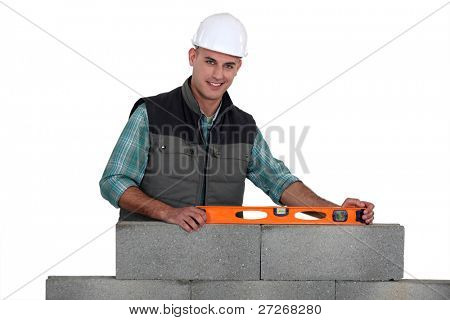 Construction worker using a bubble level