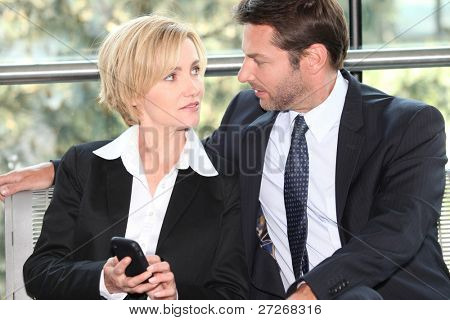 Couple of businesspeople gazing into eyes