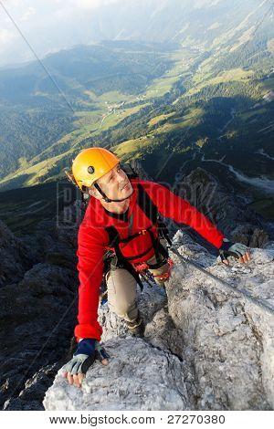 Climbing alpinist on Koenigsjodler route, Austria