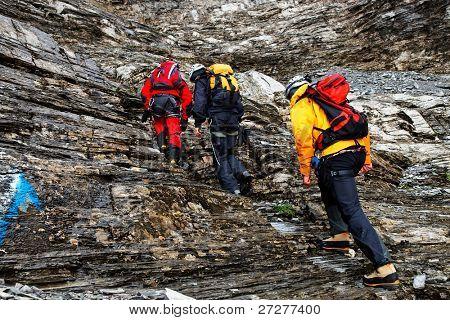 Alpinists climbing Eiger Peak, Switzerland