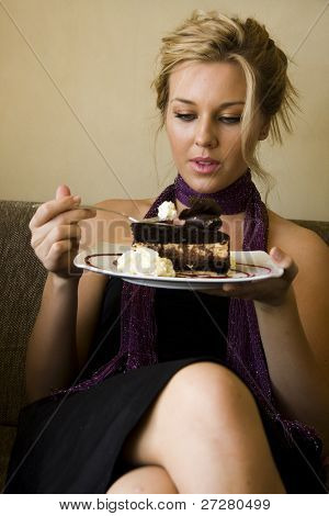 young girl at a cafe eating cake