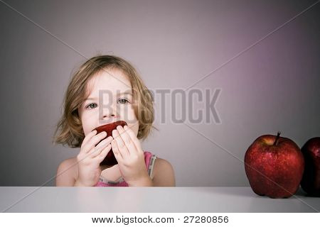 Child eating an apple