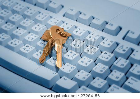 Computer security and secret concept, golden keys on blue keyboard.