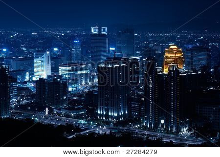 City night with lonely building and skyscraper  in Taipei, Taiwan.