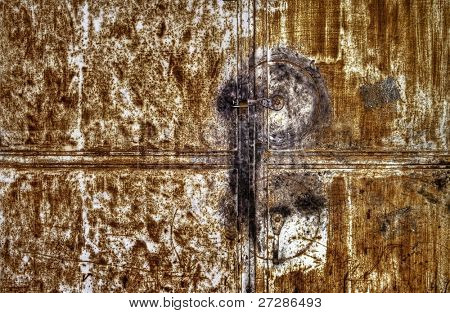 Rusty metallic door background with one lock.