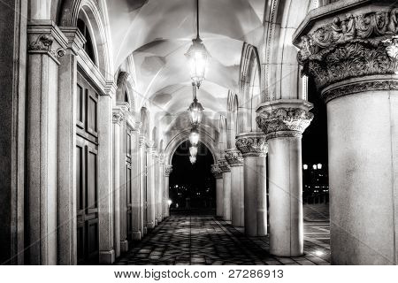 Architecture of old corridor with lamp illuminated in night.