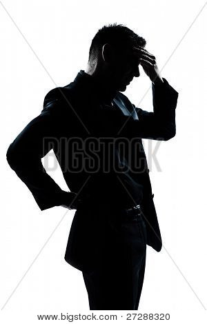 one caucasian man portrait silhouette tired migraine backache in studio isolated on white background
