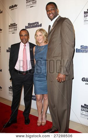 NEW YORK, NY - DECEMBER 6: Sugar Ray Leonard, Chris Evert and David Robinson attend the 2011 Sports Illustrated Sportsman of the Year awards at The IAC Building on December 6, 2011 in New York City.