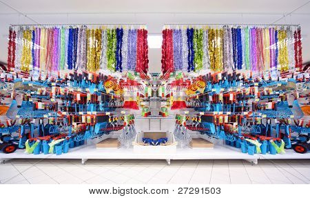 Shelves with variety of agriculture instruments inside large supermarket