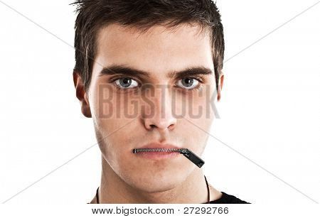 Young man with a zip on his mouth, representing censorship