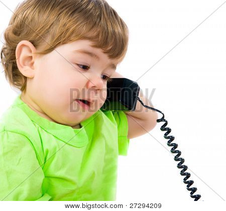 Little boy with the phone on a white