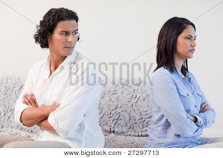 Young couple having a fight in the living room