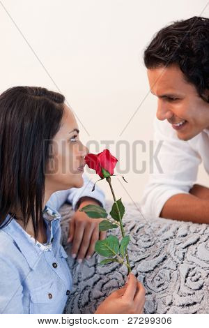 Young female got a rose from her boyfriend for valentines day