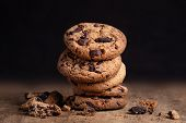 Chocolate Cookies On Old Wood Table. Chocolate Chip Cookies On Dark   Background. Copy Space poster