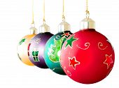 stock photo of christmas ornament  - christmas balls in a row over a white background - JPG