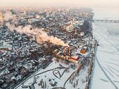 Aerial View Of Winter Cityscape With Heating Plant Or Power Station With Pipes And Smoke Or Steam, S poster