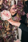 Girl Touches Flowering Branch With Hand. Roses At Home. Spring Bloom Of Sensuality. Touch The Delica poster