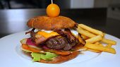 Homemade Burger With Kortoshki Fries In The Restaurant (cafe). Concept From: Big Burger, Juicy, Fres poster