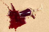 stock photo of taint  - A glass of spilled wine on brand new carpet is sure to leave a stain - JPG