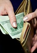 pic of tithe  - woman taking money out of his wallet - JPG