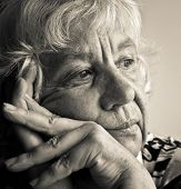 image of elderly woman  - Black and white portrait of a pensive elderly woman - JPG