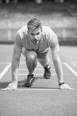 Start Of Sport Career. Man Runner On Start Position Stadium Background. Sportsman Run Outdoor At Run poster
