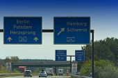 German Motorway Sign With Inscription In German Direction Arrow To The Cities - Berlin, Potsdam, Her poster