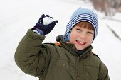 foto of snowball-fight  - child have fun with snowball fight winter outdoor - JPG