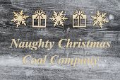 Wooden Snowflake And Christmas Presents On A Weathered Wood With Christmas Message Of Naughty Christ poster