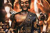 Buddha Meditating Yoga Background Bronze Orange Statue . poster